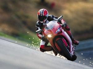 Reviews of Ducati Corse, Valentino Rossi, and Michael Schumacher 2011 2012 2013 circuit